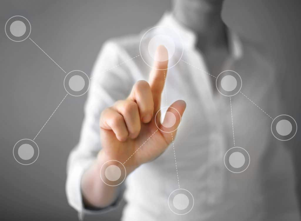 touch screen app on screen. one finger touching the screen -interactive display